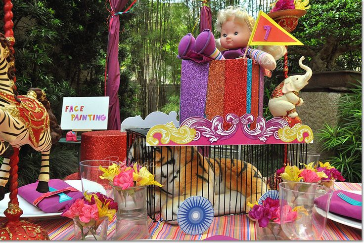 Circus themed centerpiece (circus cage with stuffed tiger, doll with pennant table number) #circustheme #centerpiece #birthdayparty