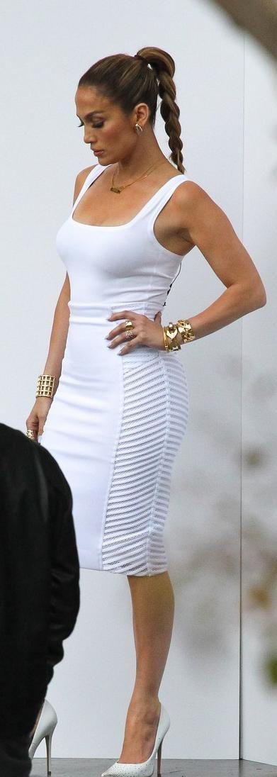 Shirt – Azzedine Alaia  Skirt – Milly  Shoes – Jimmy Choo  Earrings – Vhernier  Bracelets – Jennifer Fisher  Necklace – Jane Basch