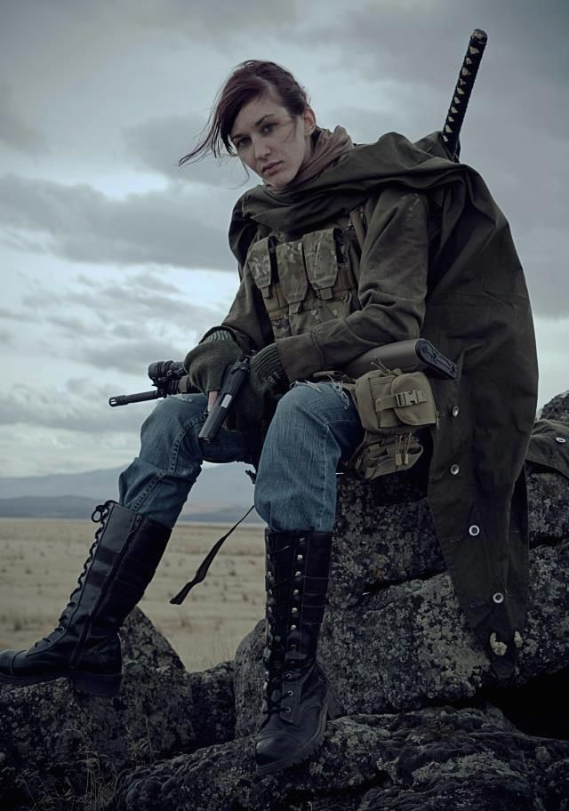 Swordswoman in the wastes.
