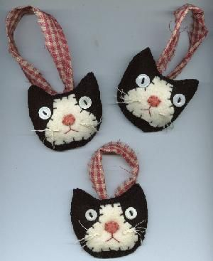 Tuxedo Cat Ornies set of three @Prim Penny: Made of handstitched felted wool, lightly stuffed, vintage button eyes, floss whiskers and cotton homespun hanger. Price: $9.99 plus $2.00 shipping. (These are sooooo cute!!)