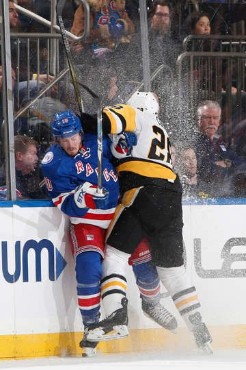 Rangers vs. Penguins - 11/23/2016 - Pittsburgh Penguins - Photos  NOVEMBER 23: Ian Cole #28 of the Pittsburgh Penguins throws a hit against J.T. Miller #10
