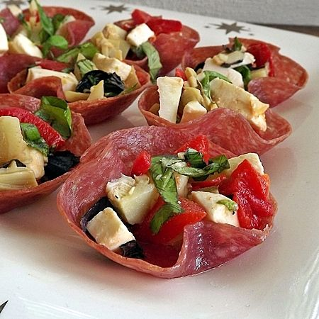 antipasto bites - bake salami slices at 400F for 10 mins in muffin tins to get formed cups