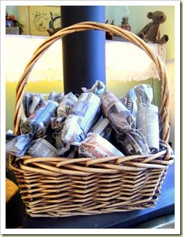Fire Starters - lint (from dryer) stuffed into toilet paper rolls, wrapped in newspaper and dipped into wax.