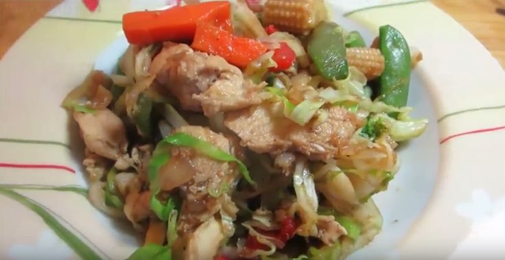 A delightful dish, featuring chicken, a colorful vegetable combination and a tasty soy sauce.