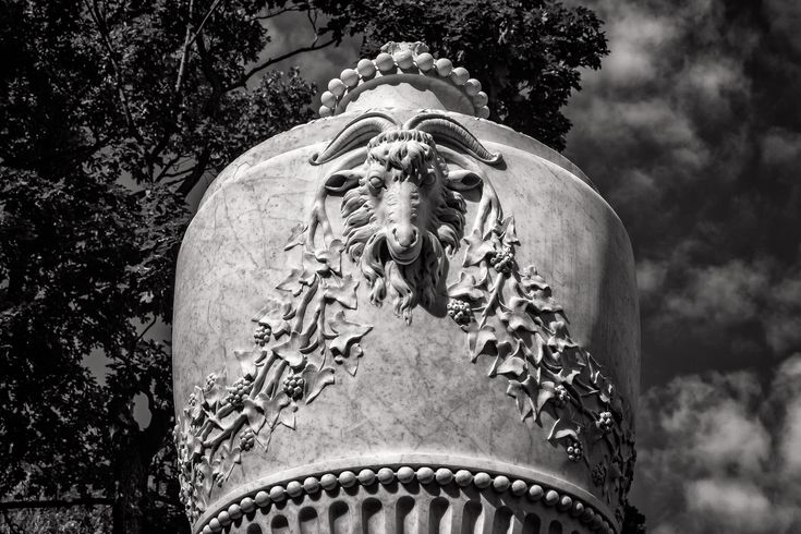 An exquisitely carved ram's head on a large pot in the gardens of Peterhof Palace near St. Petersburg, Russia.