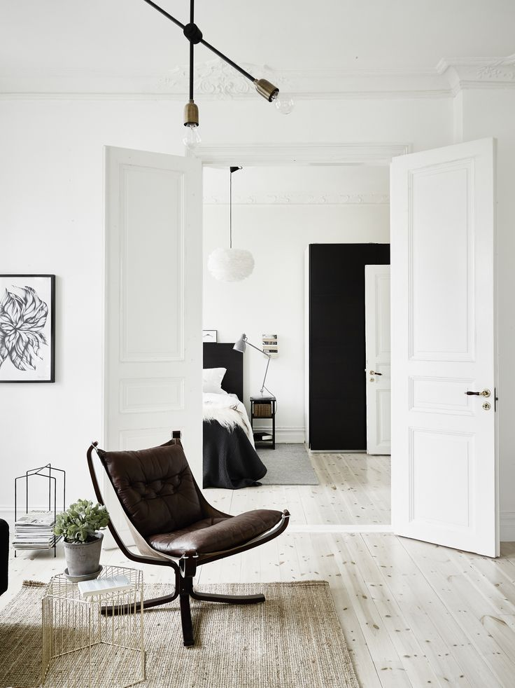 Interior, white doors, lounge chair - Roomed