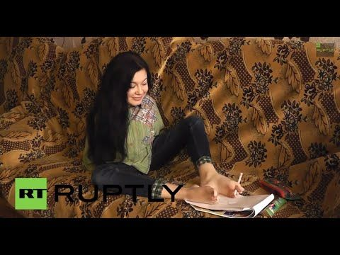 Twenty one-year-old Marina Hodyi from Sevastopol showed that having no arms does not stop her from performing every day tasks. Hodyi can cook, clean, apply make-up, write and even draw. She does all with just the use of her legs and feet, having refused to use prosthetic limbs.