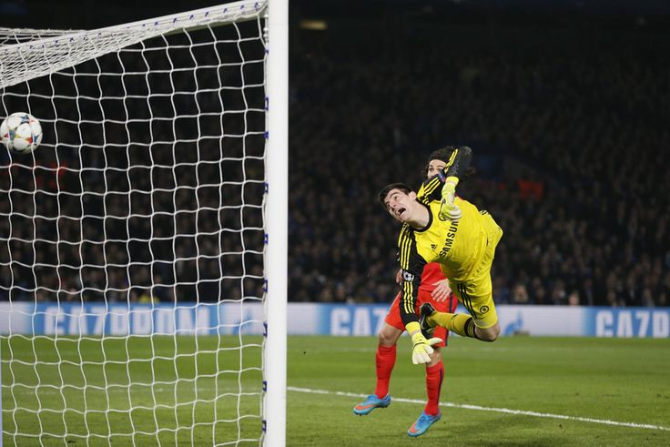 Thiago Silva (not pictured) scores the first goal for PSG as Chelsea's Thibaut Courtois looks on