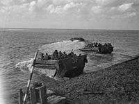 Buffalo amphibious vehicles taking troops of the Canadian First Army across the Scheldt in Holland, September 1944.
