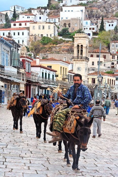 Man on donkey, in Hydra island - Greece.