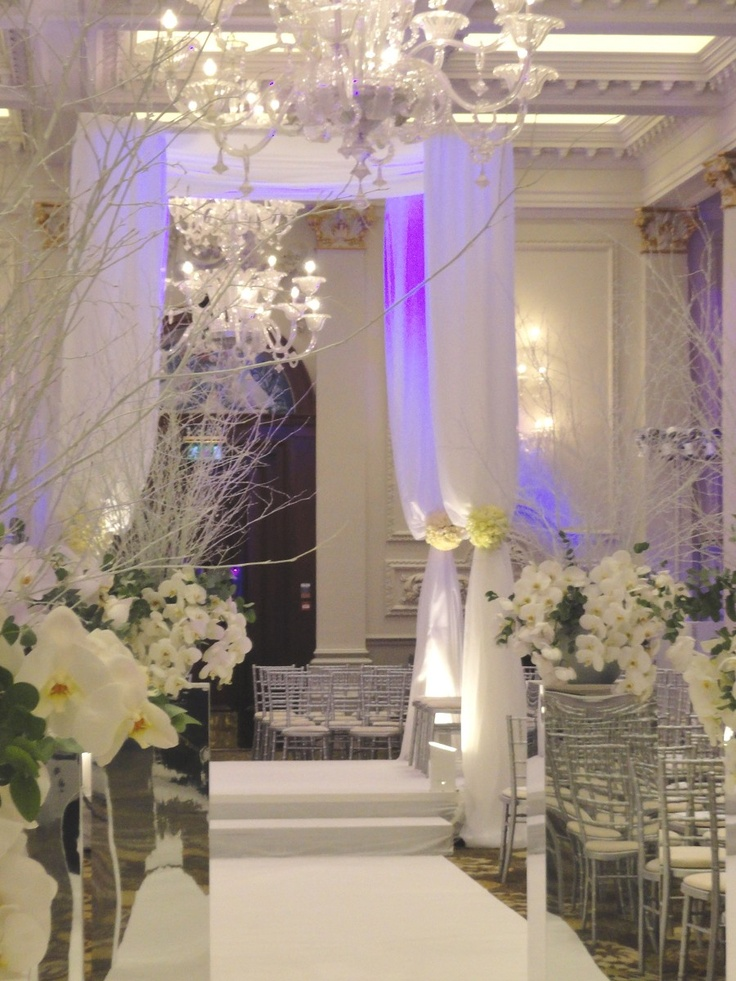 White chuppah with white flowers #sleek #sophisticated