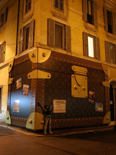 louis vuitton shop in rome (near spanish stairs). Louis Vuitton knows how to guard his shop at night! :)