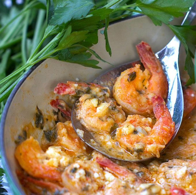 Greek Style Garlicky Shrimp: a steaming pot of shrimp in spicy lemon-garlic sauce with melted feta - serve with crusty bread to sop up every delicious drop.