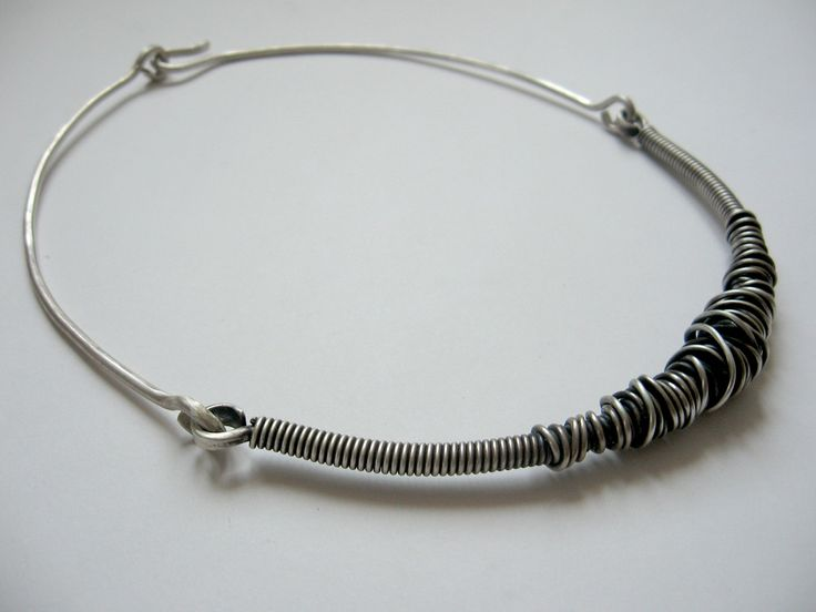 silver necklace, coiled wires with different gauge create its shape.