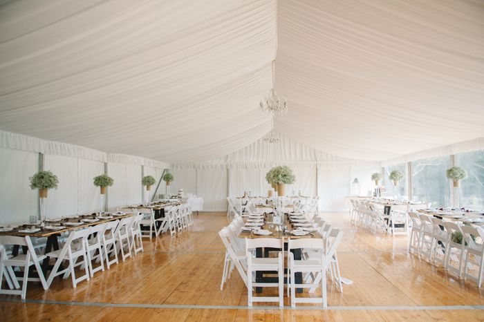 silk lining, chandeliers, 10m marquee structure, integrated timber flooring, clear walls, vintage timber tables, white padded folding chairs, south coast weddings, south coast party hire