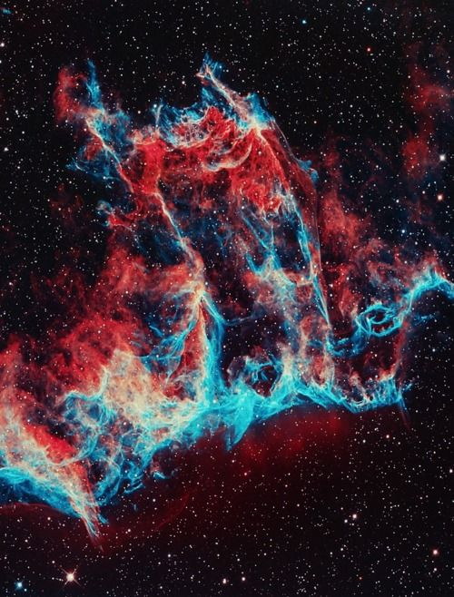 The Veil Nebula is a cloud of heated and ionized gas and dust in the constellation Cygnus. It constitutes the visible portions of the Cygnus Loop (radio source W78, or Sharpless 103), a large but relatively faint supernova remnant. The source supernova exploded some 5,000 to 8,000 years ago, and the remnants have since expanded to cover an area roughly 3 degrees in diameter (about 6 times the diameter, or 36 times the area, of the full moon). Seen here is the the Eastern Veil Caldwell 33.
