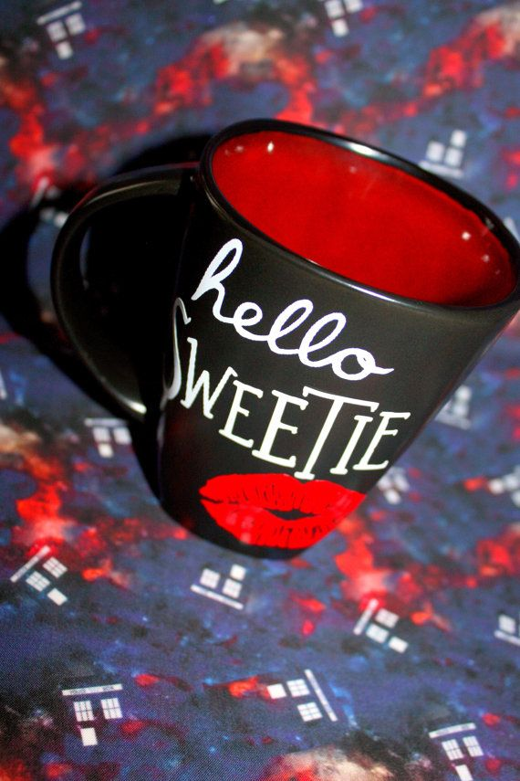 14oz ceramic coffee cup with a glossy finish and high quality vinyl featuring Hello, Sweetie with a kiss. (This cup may be slightly different than pictured due to shop changing suppliers) Please note that this mug is printed on the right hand side, if you need a left hand side print