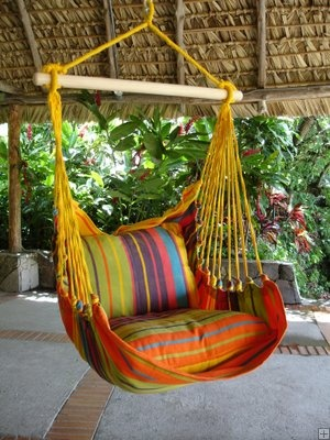 {lots of wonderful hammocks and hanging chairs.   Unfortunately they're at the Farmer's Market in Amsterdam.  But some of their lines are made in Mexico - Yucatan!}