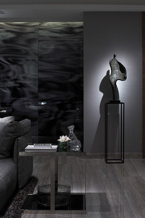 I like the sculpture, and the wall is strangely hypnotic....- STEVE LEUNG DESIGNERS - Project Pages