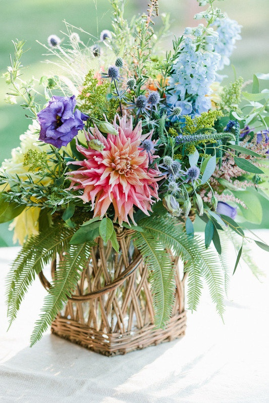 Dahlia with cottage garden flowers including echinops, delphinium, lisianthus and ferns