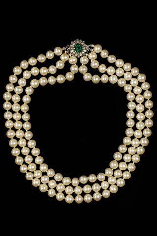 Jacqueline Bouvier Kennedy Onassis wore her triple-strand pearl necklace designed by American jeweler Kenneth Jay Lane. It became her signature piece of jewelry during her time as First Lady in the White House.