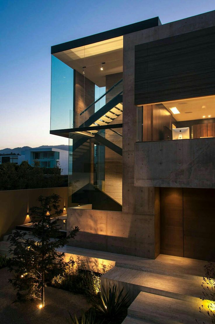 Brutalist architecture, but softened by the use of glass and muted lighting.