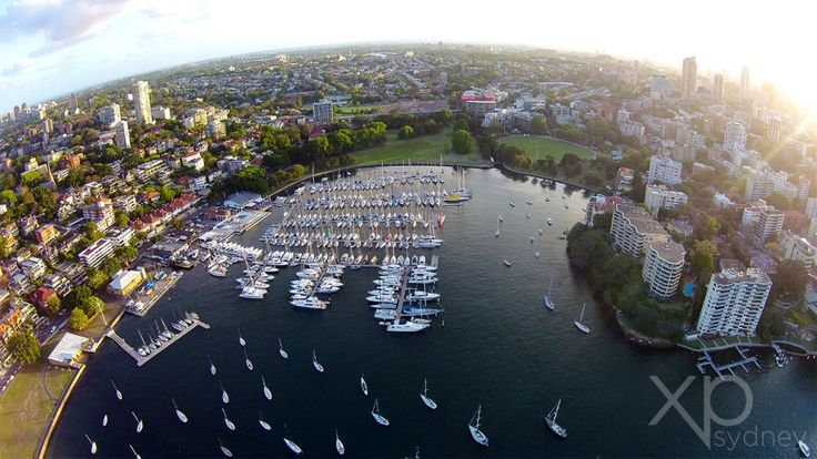 Rushcutters Bay is an impressive space surrounded by giant Moreton Bay fig trees, hundreds of luxury yachts and no lack of top class restaurants.