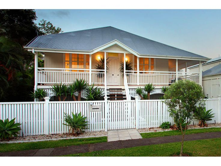 Queenslander gable at top of stairs, low white fence