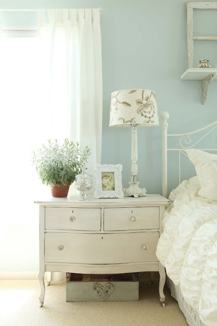 Beautiful blue wall color as a backdrop to crisp white linens and accessories.