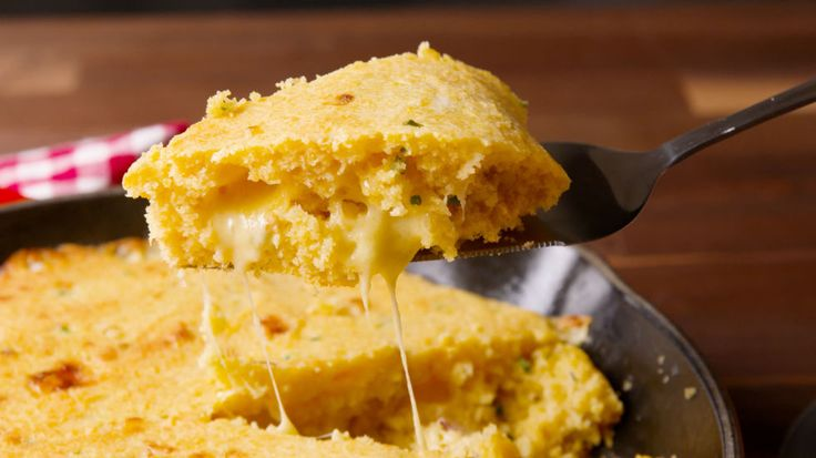This isn't your ordinary cheesy cornbread. It's cornbread STUFFED with an entire layer of cheese.Get the recipe from Delish.