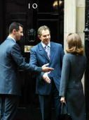 LONDON - DECEMBER 16: British Prime Minister Tony Blair (R) greets Syrian President Bashar al-Assad (L) and his wife Asma al-Assad (C) as they arrive December 16, 2002 in London. President Assad is in London for talks about the Iraqi conflict and the Middle East situation. (Photo by Scott Barbour/Getty Images)