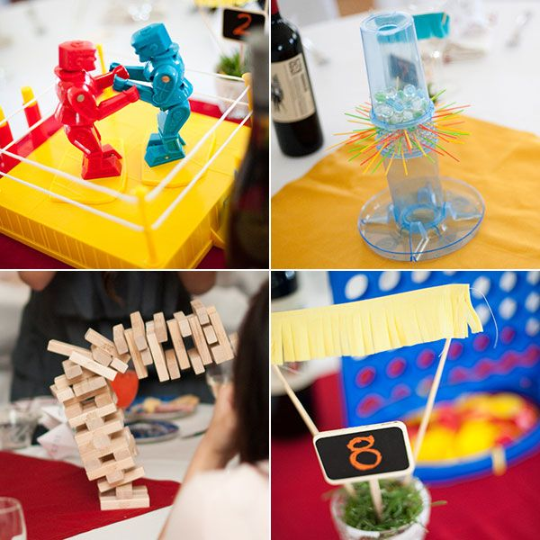 Table Games: Board Games  Instead of floral centerpieces, place a game at the center of each table. Encourage your guests to swap with other tables throughout the night for endless fun. Or, add a game station, where guests can grab a board game for their table.