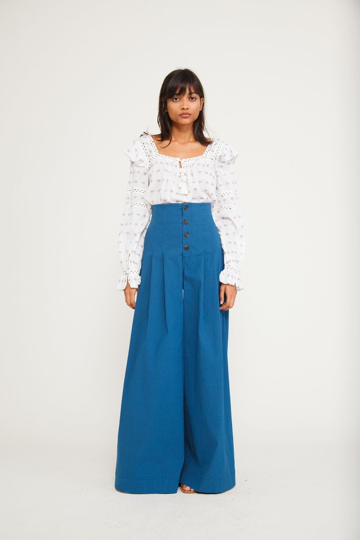 A corset style high waist line brings a romantic flair, fit and flow to our wide-legged pants.
