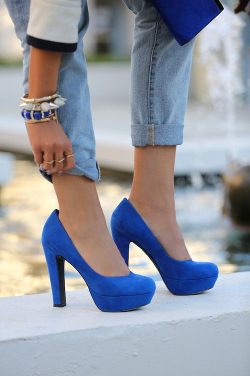 Blue heels and folded up jeans.