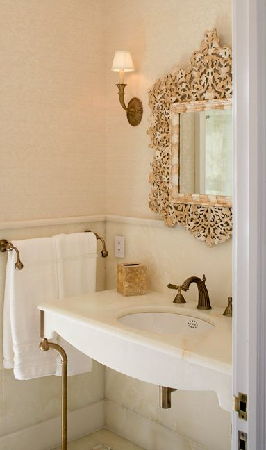 ornate mirror + marble washbasin