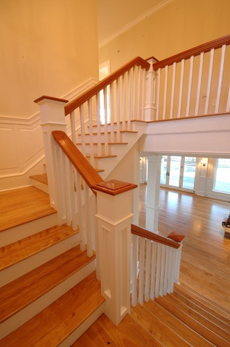 Mallets Bay Shingle traditional staircase  I have a nice staircase, but I'm considering painting portions white like this.  It's scary to be the first one to paint original, stained woodwork; so hard to go back once it's done!