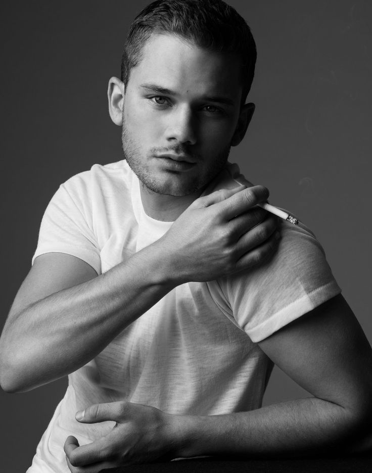Jeremy Irvine with a cigarette in his hand