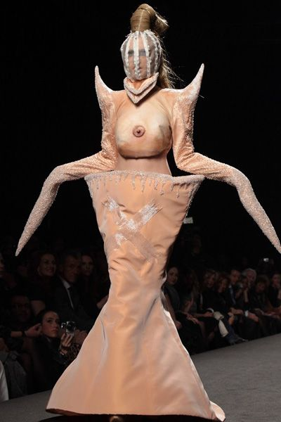 Gianni Molaro. Well, I thought I had seen it all, but this is... a tit dress. It's a tit monster or something. This is either the weirdest couture I have ever seen... or the best Halloween costume EVER.