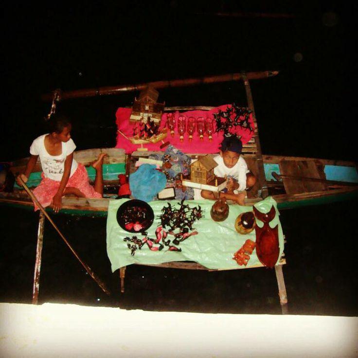 "Tribes called: Samal. Selling souvenirs on Canoe ""Bangka"" in Zamboanga City, Philippines"