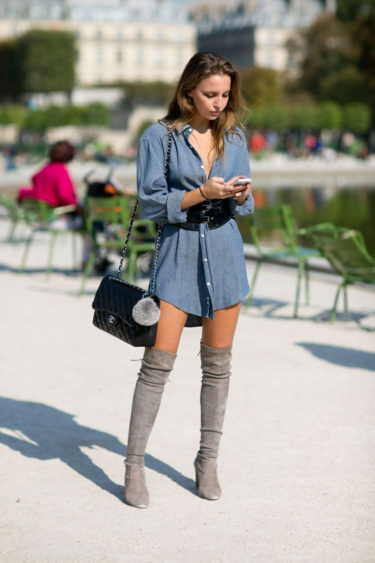 An oversized denim shirt may not seem like fashion week material, but where there's a little inventive accessorising, there's a way. Add a pair of thigh-high suede boots, a corset belt and a chic Chanel bag, and you've got yourself street style ready.