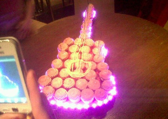 Guitar Cupcake cake with lights by cupcakes and fairy cakes