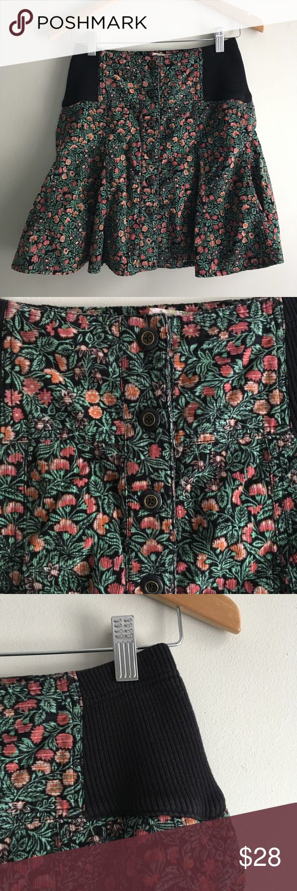 """Free People Floral Boho Velour Button Front Skirt Unique Free People skirt in a pretty floral print. Black panels along sides are elastic so there is some flexibility in the sizing. Fitted at the top and then flares about halfway down (almost like a short trumpet skirt!). Fabric is really cool - almost like a velour or velvet texture. Good used condition - no flaws to note!  13"""" waist when measured flat 17"""" long All measurements are approximate. Free People Skirts Mini"""