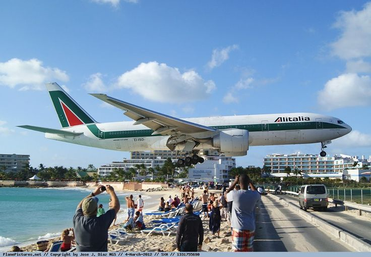 Princess Juliana International Airport in St. Maarten. Planes get so low over the beach it's hard to believe...