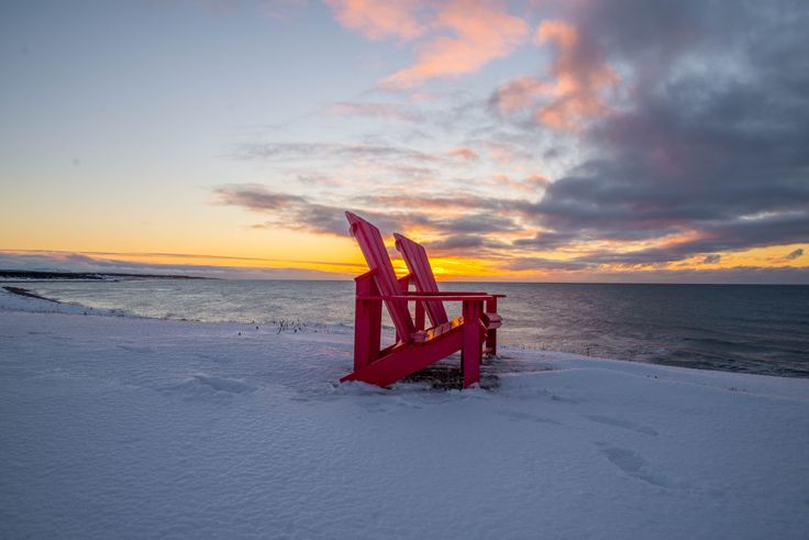Sunset on Parks Canada Red Chairs in Gros Morne National Park
