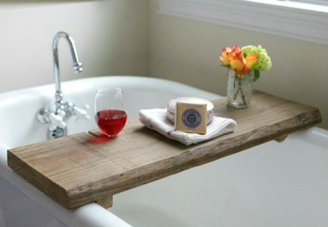 Turn reclaimed wood into a bathtub tray to add an element of warmth and relaxation to a soaker tub. And a handy notch means you don't even have to hold your wine glass.