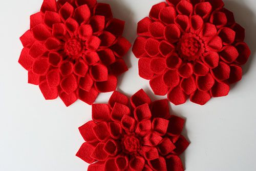 felt dahlias - I would love to have the patience to make one of these or the style to wear one. Will have to work on that.