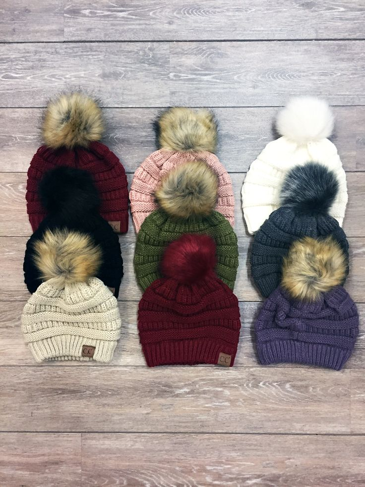 We're restocking these cozy beanies all season long! This knit hat has a slouchy design with a vegan fur pom-pom on top, making it perfect for fall & winter.