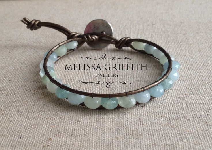 Aquamarine Rondelle Leather Wrap Bracelet (MGB78) $39.00 This bracelet features faceted aquamarine rondelle beads that have been hand strung onto metallic copper leather cord with a button closure.