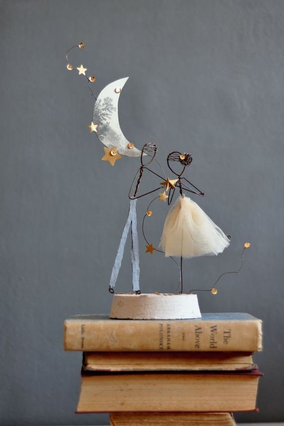 This is the sweetest cake topper ever. Under the moonlight wedding cake topper.