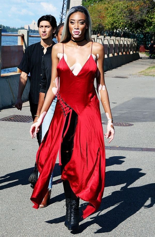 Canadian model Winnie Harlow stepped out during New York Fashion Week in this bright red DKNY dress.... - Street Style
